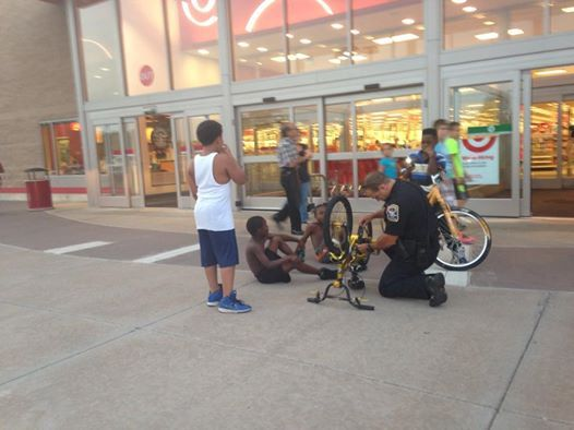 Photo of 'Officer Friendly' fixing boy's bike goes viral