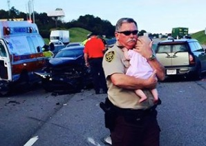 Pic of deputy comforting baby at crash scene goes viral
