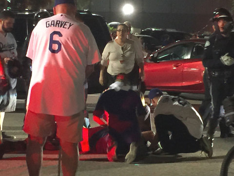 1 remains hospitalized after fight outside Dodger Stadium
