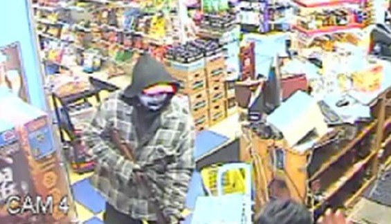 Suspected robber forced gun into clerk's mouth before shooting
