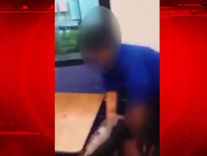 Viral video shows assault on boy; teacher's aide in custody