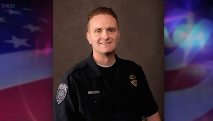 Police ID officer fatally shot in head while responding to traffic accident