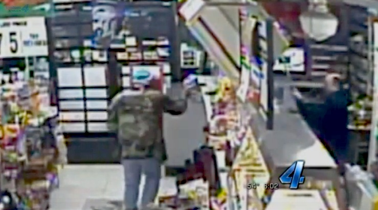 Caught on video: Store clerk scares off robber with crowbar