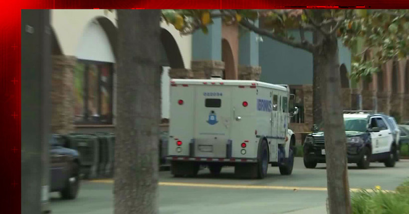 Armed man steals cash from Brink's armored truck in daylight Granada Hills robbery