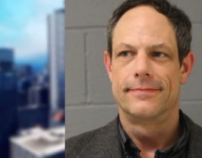 Newtown teacher charged with bringing gun to middle school