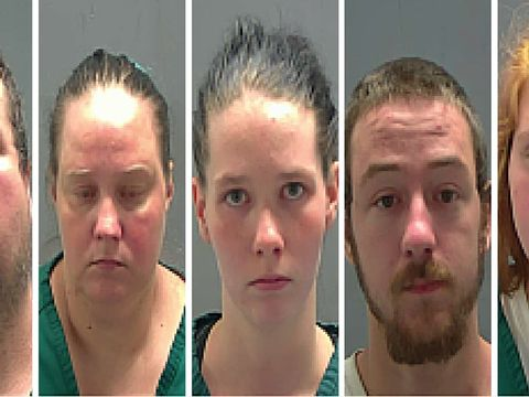 5 arrested after autistic woman found living in backyard cage