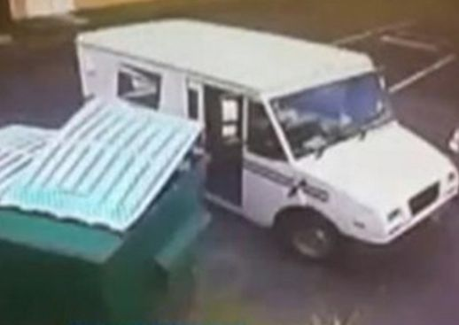 Postal worker caught throwing mail in trash