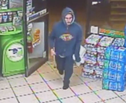 Caught on video: Hammer-wielding robber stopped in his tracks