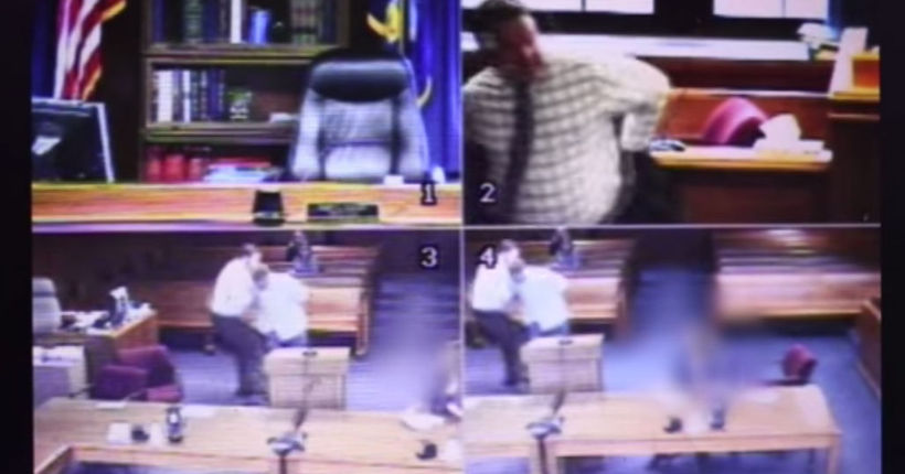 Video shows judge tossing robe, helping to restrain man