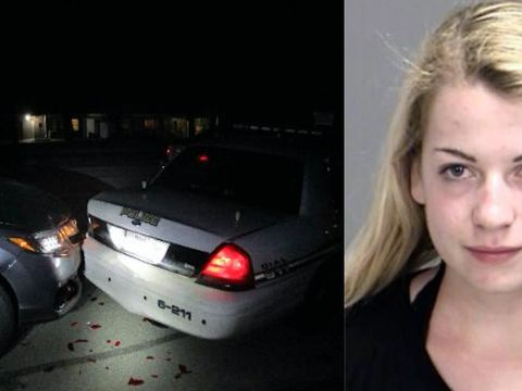 Student crashes into cop car after taking topless selfie