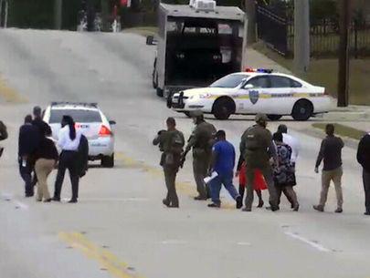SWAT team rescues hostages, ends bank standoff