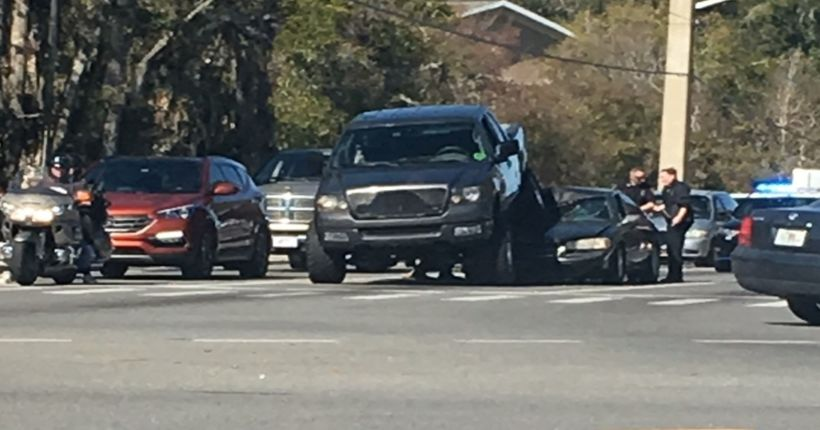 Man parks truck on top of car to defend family in road rage incident, police say