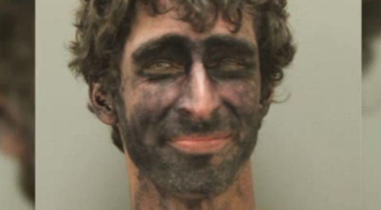 Man with black ink all over face tells cops he is 'the law'