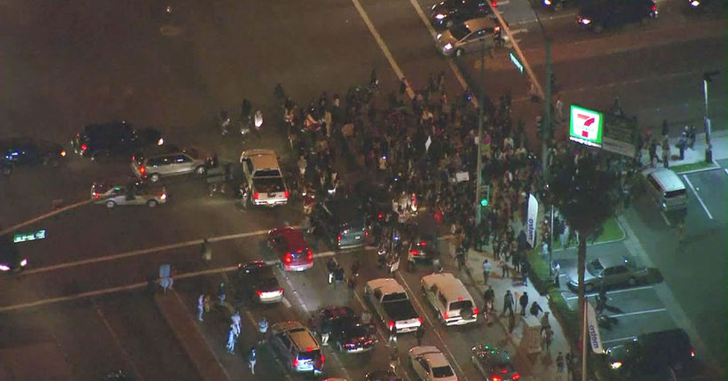 24 arrested in Anaheim after protests sparked by struggle between off-duty LAPD officer, teen