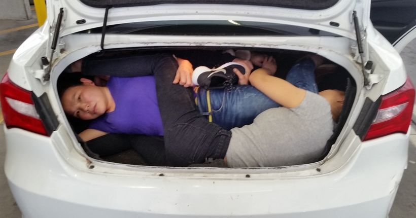 Driver arrested at border after 4 Chinese people found crammed in trunk
