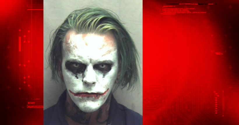 Man carrying sword, dressed as The Joker arrested