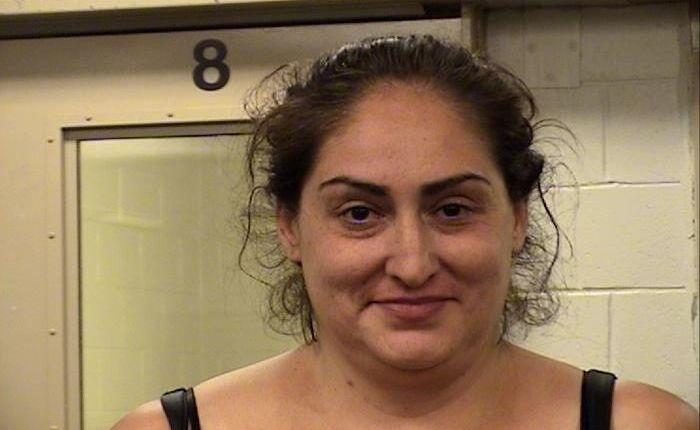 Woman accused of charging neighbor with samurai sword