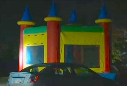 Three shot, including kids in bouncy house, at birthday party