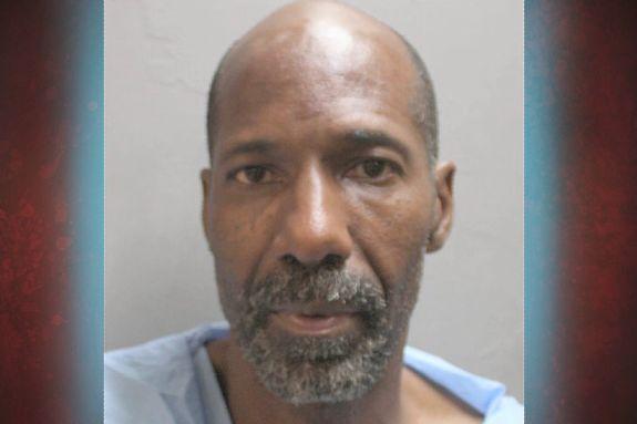 Man accused in 3 shootings, including death of wife, found sleeping in park