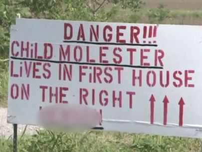 Dad posts 'child molester' sign over daughter's relationship