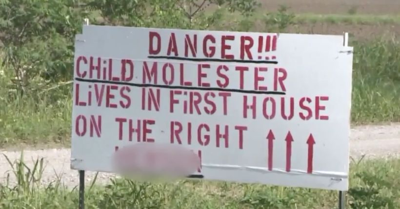Dad posts 'child molester' sign over daughter's relationship with neighbor