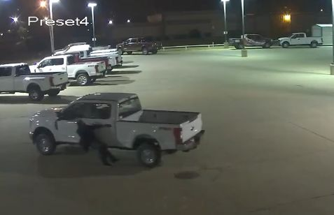 Video: Truck rolls away from would-be thieves on lot