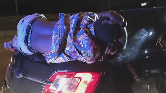 Couple unwittingly drives onto highway with drunk man on their trunk