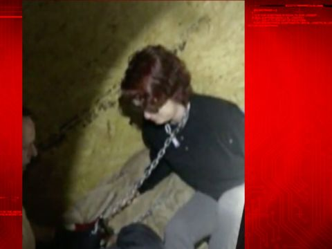 Videos show rescue of rape victim chained in metal container