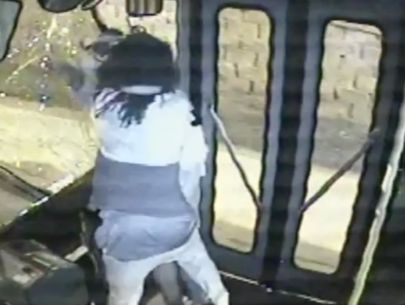 Fight on bus sends man with knife through windshield
