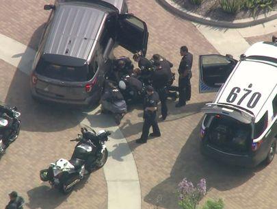 LAPD officer, homicide suspect injured after pursuit ends in gunfight