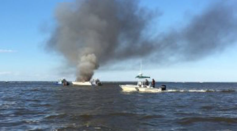 70-year-old man rescues couple and their dogs after boat catches fire at Barrett Beach