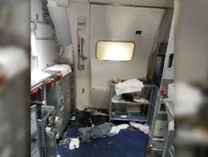 FBI: Flight attendant broke wine bottle over man's head
