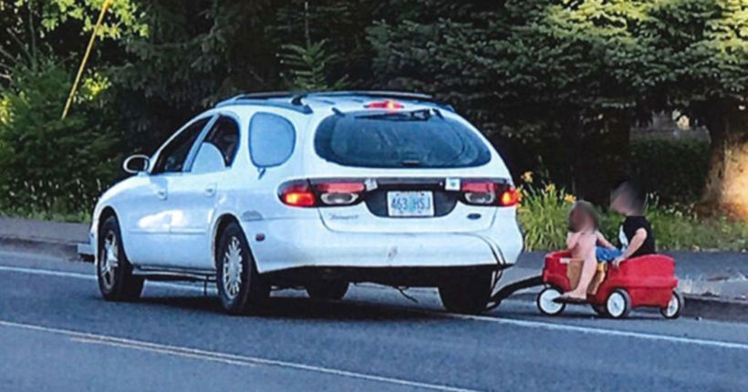 Oregon mother arrested after using car to tow kids in plastic wagon