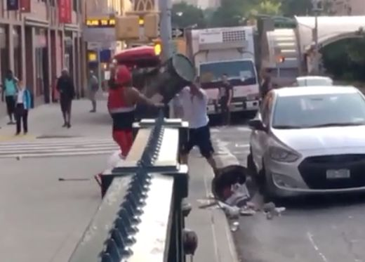 Video: Machete-wielding driver attacks man using garbage can to defend himself
