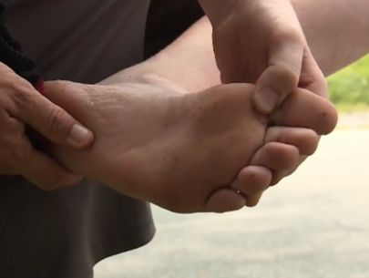 Barefoot boy steps on bag of dirty needles at playground