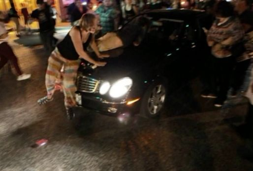 Driver injures protesters at vigil for transgender woman killed by police
