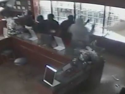 Video: 12 burglars break into business in smash-and-grab