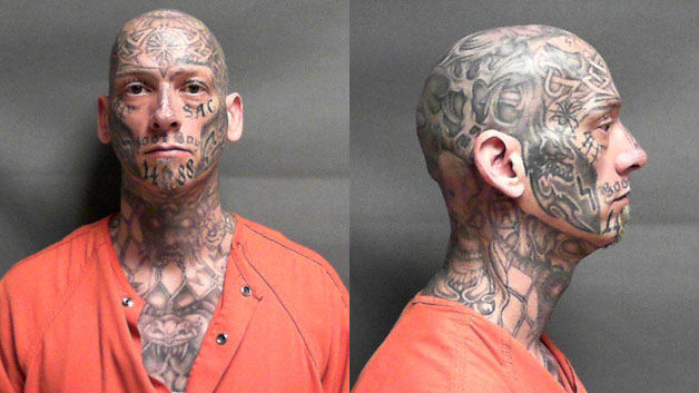 U.S. Marshals looking for heavily-tattooed fugitive