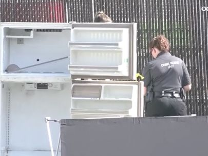 Young man's body found in refrigerator on street, prompting investigation
