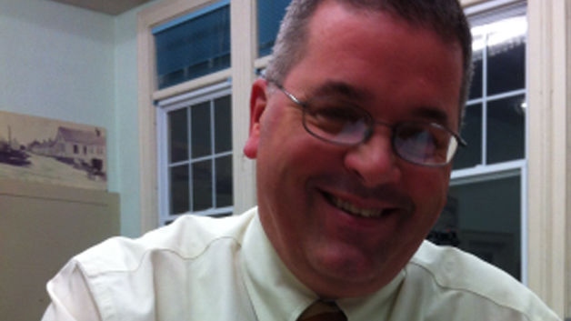 Planning Board member charged with taking 'upskirt' photos at Dartmouth bank
