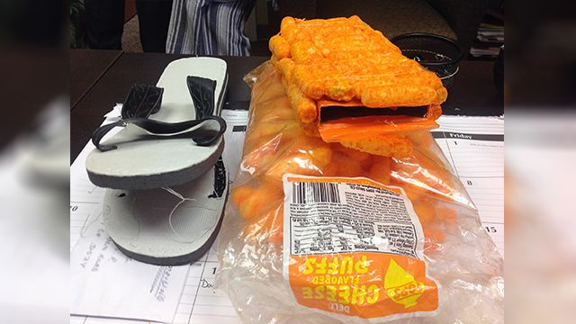 Officers confiscate cellphones disguised as cheese puffs, flip-flops