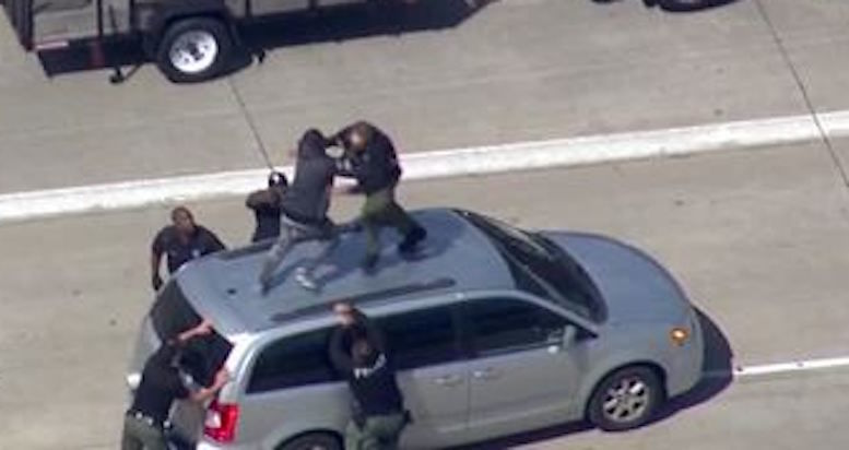 Video: Dramatic takedown of Detroit chase suspect on top of car on I-75