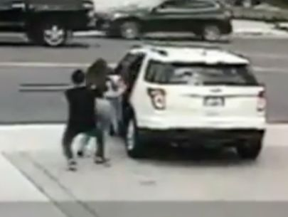 Surveillance video captures man being dragged by car after phone theft