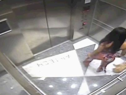 Surveillance camera catches woman kicking dog in elevator
