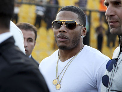 Rapper Nelly arrested for alleged rape on tour bus after concert