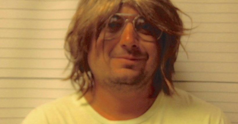 Victim's family 'appalled' after Oklahoma man accused of domestic assault poses in wig, glasses for mug shot