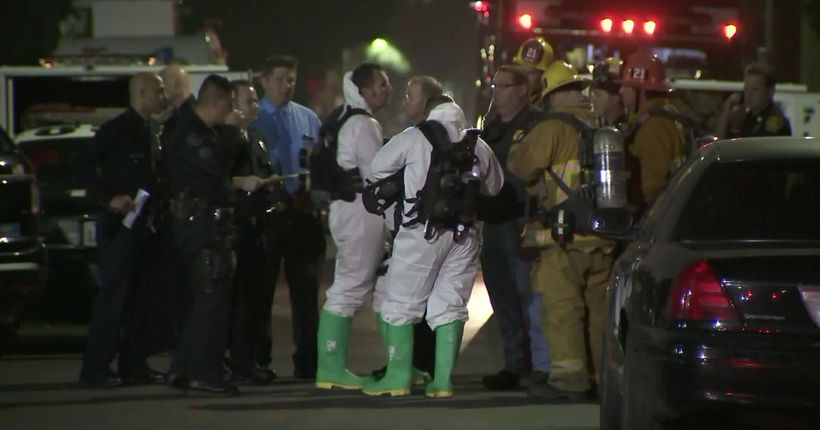 Baby covered in white powder dies after being found naked alongside woman, child in South L.A. parking lot