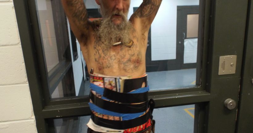 Oklahoma man taped adult magazines to his body after allegedly challenging former neighbor to knife fight