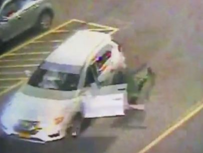 Video: Shoplifters fleeing in SUV drag security guard through mall parking lot