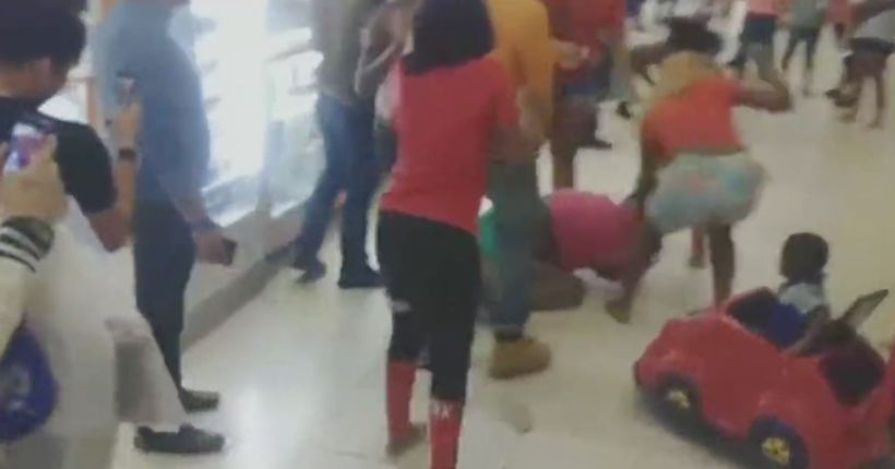 Child in stroller caught up in Florida mall brawl